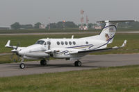G-WVIP @ EGJB - Taxiing for departure at Guernsey; note the Capital Air Ambulance title and logo on the tail - by alanh