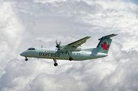 C-GKOB @ CYVR - Landing on 26R - by Guy Pambrun