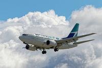 C-GWSK @ CYVR - Landing on 26R - by Guy Pambrun