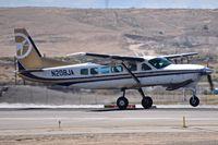 N208JA @ KBOI - Take off run on RWY 28R. Cessna 208B, s/n 208B2174. - by Gerald Howard