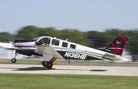 N136HB @ KOSH - G36 departing Oshkosh - by Eric Olsen