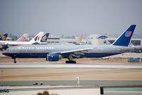 N796UA @ KLAX - UA B772 vacating the runway - by FerryPNL