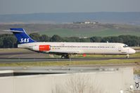 EC-JRR @ LEMD - Spanair MD87 in SAS livery. Frame stored in KIGM since 2010. - by FerryPNL