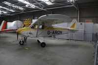 G-ARON @ EGBE - Seen parked inside hangar - by AirbusA320