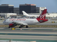N523VA @ LAX - old branson gets everywhere - by magnaman