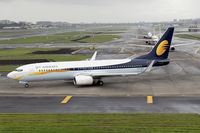 VT-JFY @ VABB - Taxiing out for departure to Bengaluru as 9W443 on an overcast morning.