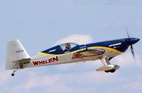 N821MG @ KOSH - Extra EA-300S  C/N 1035, N821MG