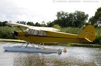 N33587 @ KOSH - Piper J3C-65 Cub  C/N 14064, NC33587 - by Dariusz Jezewski www.FotoDj.com