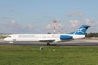 4O-AOM @ LMML - Fokker100 4O-AOM Montenegro Airlines - by Raymond Zammit