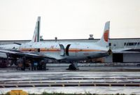 N44DG @ MIA - Awaiting attention at MIA during March 1990 and displaying the part titlle and colours of a previous opertator, PAT (Petroleum Air Transport) - by Goat66