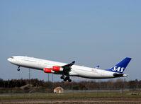LN-RKP @ EKCH - LN-RKP taking off rw 22R - by Erik Oxtorp