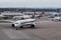 9V-SMN @ EGCC - Just landed at Manchester. - by Graham Reeve