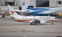 PZ-TCS @ KMIA - Surinam 737-700