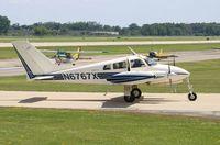 N6767X @ KOSH - Cessna 310F - by Mark Pasqualino