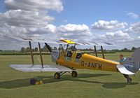 G-ANFM @ EGTH - 1940 Tiger Moth being turned ready for taxiing at the Old Warden 'Gathering of Moths' Day 2019 - by Chris Holtby