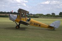 G-ANFM @ EGTH - 1940 Tiger Moth returning after flying display at Old Warden's Gathering of Moths 2019 - by Chris Holtby