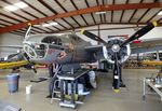 N7705C @ KADS - Douglas A-26C Invader in the maintenance hangar at the Cavanaugh Flight Museum, Addison TX