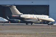N413FX @ KCRQ - Flexjet EMB545 under tow after arrival from Mexico. - by FerryPNL