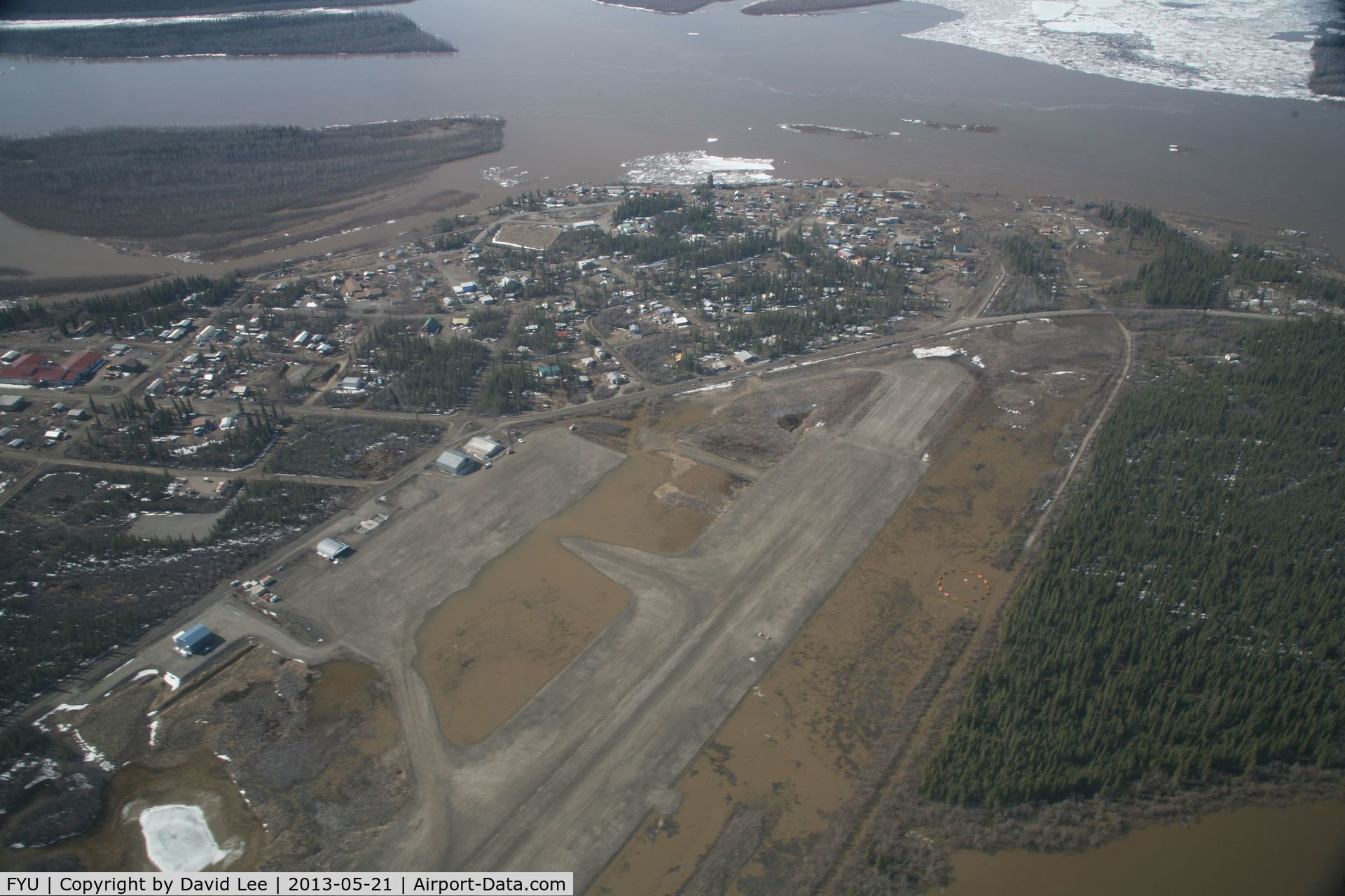 Fort Yukon Airport (FYU) - Fort Yukon, Alaska.  Minor flooding of ramp during breakup of Yukon River.  Taken from Wright Air N4637U piloted by Dave Lorring.