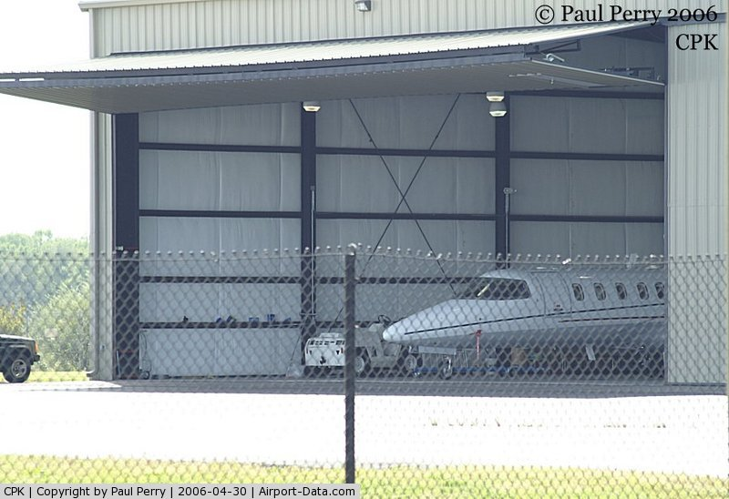 Chesapeake Regional Airport (CPK) - Biz-Jet poking her nose out of the hangar a bit