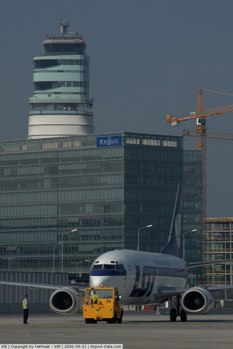 Vienna International Airport, Vienna Austria (VIE) - LOT Boeing 737 pushing back infront of the office park and the control tower