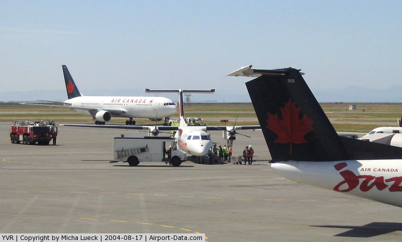 Vancouver International Airport, Vancouver, British Columbia Canada (YVR) - Some incident triggered the fire crew out to Air Canada Jazz's DHC 8