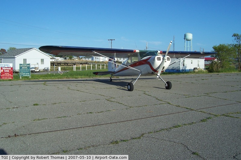 Tangier Island Airport (TGI) - C140 at the edge of parking lot.