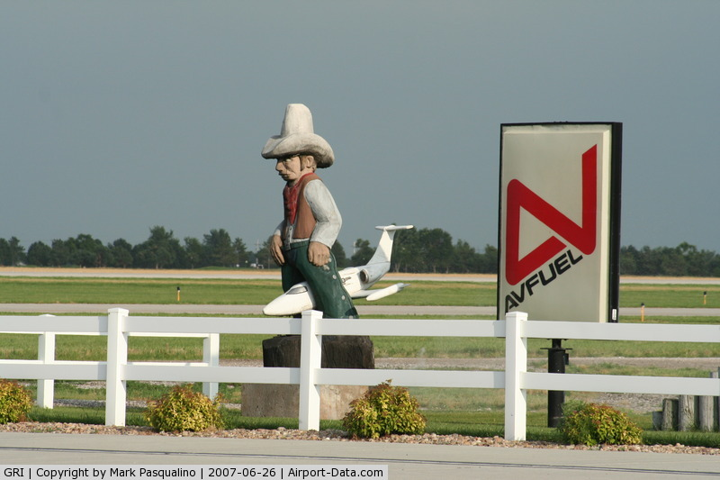 Central Nebraska Regional Airport (GRI) - Cowboy on top of a Lear Jet at the General Aviation Terminal.