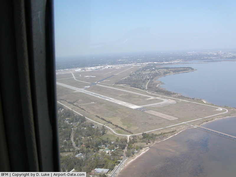 Mobile Downtown Airport (BFM) - Entering right downwind, RWY 14.  Mobile Bay at right.
