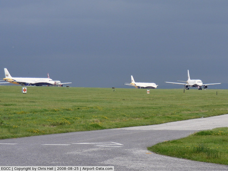 Manchester Airport, Manchester, England United Kingdom (EGCC) - Three Monarch Airbuses and a Jet2 Boeing 737 waiting to depart