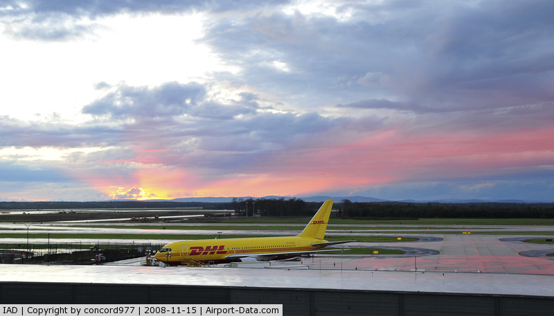 Washington Dulles International Airport (IAD) - Stormy sunset west of KIAD on 11/15/2008.  N775AX in the foreground.