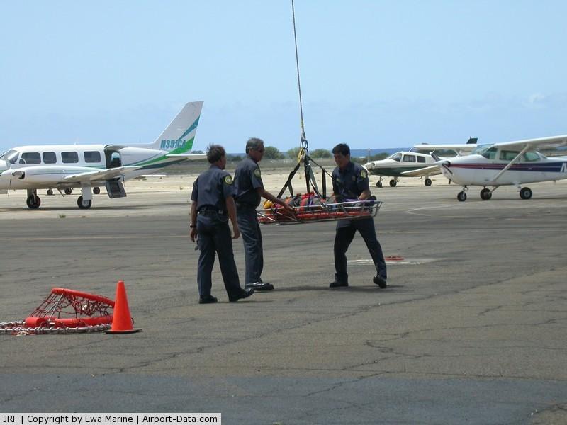 Kalaeloa (john Rodgers Field) Airport (JRF) - Rescued Jet Pilot!-JRF ramp in front of Hangar 111. 2003