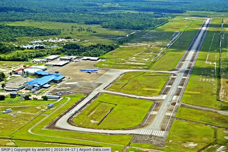 Johan Adolf Pengel International Airport (Zanderij Int'l), Zanderij Suriname (SMJP) - Overview of SMJP RWY 11/29 with on the ramp a KLM MD-11, two Surinam Airways B733 in/ outside the hangar, and a few domestic airline birds on the ramp.