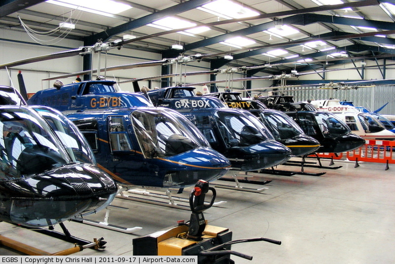 Shobdon Aerodrome Airport, Leominster, England United Kingdom (EGBS) - lineup of Bell 206 Jetrangers in the Tiger Helicopter's hangar at Shobdon. From L to R, G-OMDR, G-BYBI, G-XBOX, G-ONTV, G-SPEY, G-DOFY, G-BSBW.
