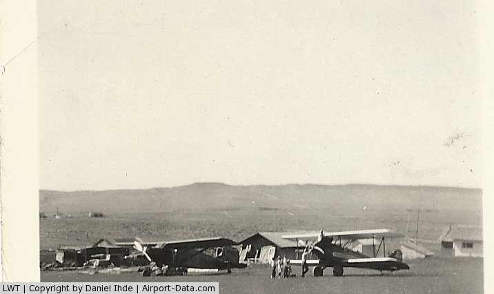Lewistown Municipal Airport (LWT) - 1935 60 miles east of Lewistown Mt.  One penny per pound rides.  These planes landed on the ranch where my dad grew up because of the flat terrain.