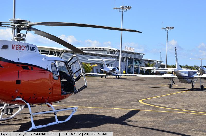 Vilankulo Airport, Vilankulo Mozambique (FQVL) - Vilankulos' busy apron with new terminal building in background.