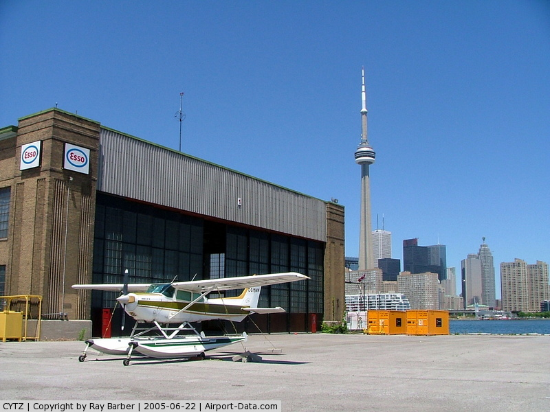 Toronto City Centre Airport, Toronto, Ontario Canada (CYTZ) - Showing the old hangar and skyline behind.