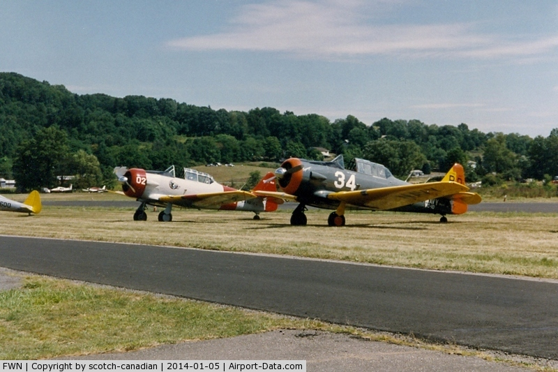Sussex Airport (FWN) - North American T-6 and SNJ at the 1993 Sussex Air Show, Sussex, NJ