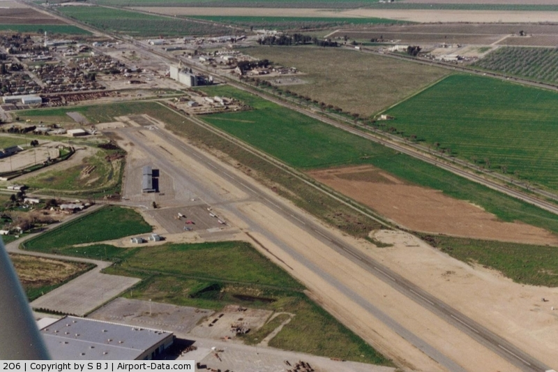 Chowchilla Airport (2O6) - As it looked in 1994. View is north.Most activity is Ag operations. Highway 99 is seen on the far right.
