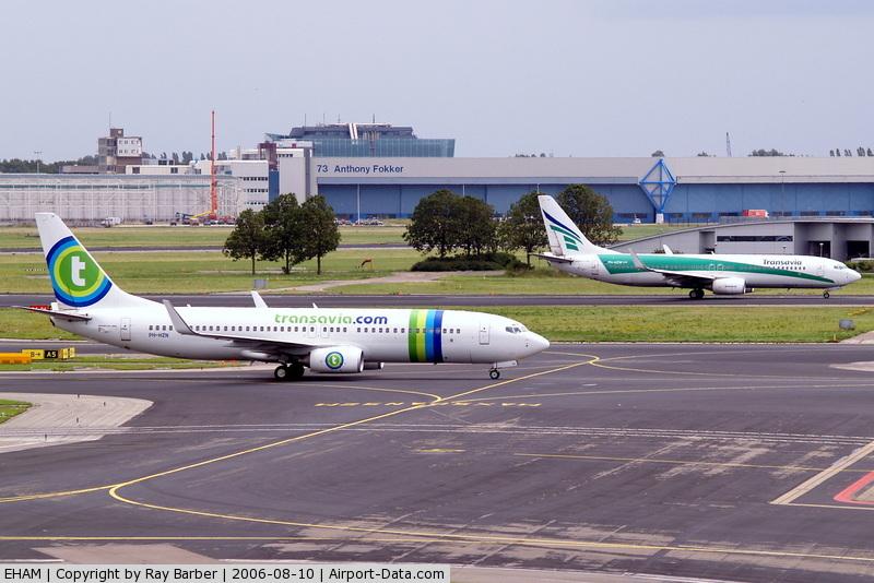 Amsterdam Schiphol Airport, Haarlemmermeer, near Amsterdam Netherlands (EHAM) - Showing new and old Transavia scheme.