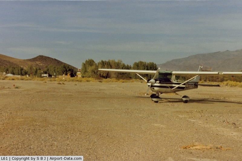 Shoshone Airport (L61) - 02x at Shoshone showing the short distance to town and the trees that you fly over on short final if landing on runway 15.Runway 33 is upslope with obstructions so a go around can be problematic.Was a fatal acc on a go around on 8-18-73.