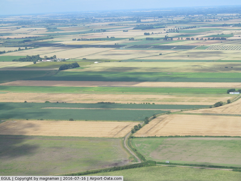 RAF Lakenheath Airport, Lakenheath, England United Kingdom (EGUL) - Actually Mitchells Farm strip near Wilburton not far from Lakenheath. Strip crosses left to right with hangar on right (north end) of strip