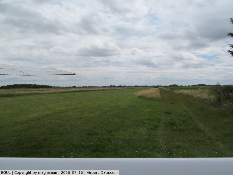 RAF Lakenheath Airport, Lakenheath, England United Kingdom (EGUL) - Mitchells Farm strip near Lakenheath - view over fuselage of G-LSCM - windsock on right