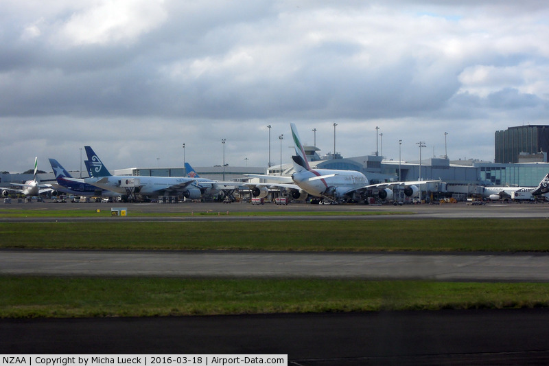 Auckland International Airport, Auckland New Zealand (NZAA) - Busy international terminal: 2 EK A380, LA B788, CZ 788, NZ 772, NZ A320