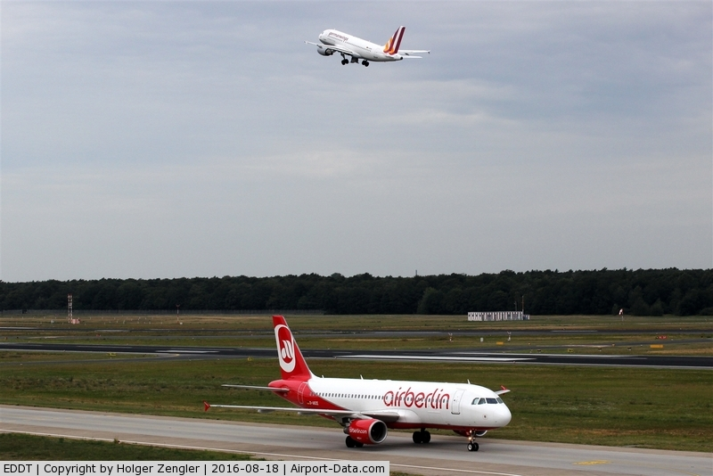 Tegel International Airport (closing in 2011), Berlin Germany (EDDT) - Coming and going unter a grey sky....