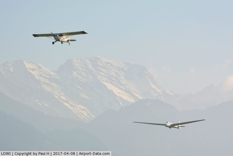 Innsbruck Airport, Innsbruck Austria (LOWI) - Towing a glider out off LOWI, Innsbruck with the austrian alps in the background
