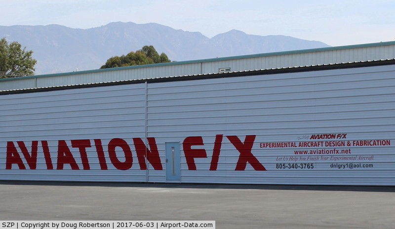 Santa Paula Airport (SZP) - AVIATION F/X has designed, built, modified, improved, or otherwise finished over fifty varied Experimental Aircraft airworthy completions. New sign on their repainted huge hangar.
