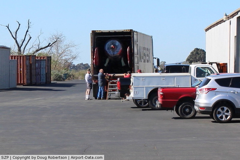 Santa Paula Airport (SZP) - MAERSK LINE arrival truck to unload Kimball PITTS Model 12 biplane aircraft for reassembly. Maersk  is largest international shipper using ocean freighters. Location-behind Ray's Aviation. Some ocean freight containers in left side past Tee Hangar.
