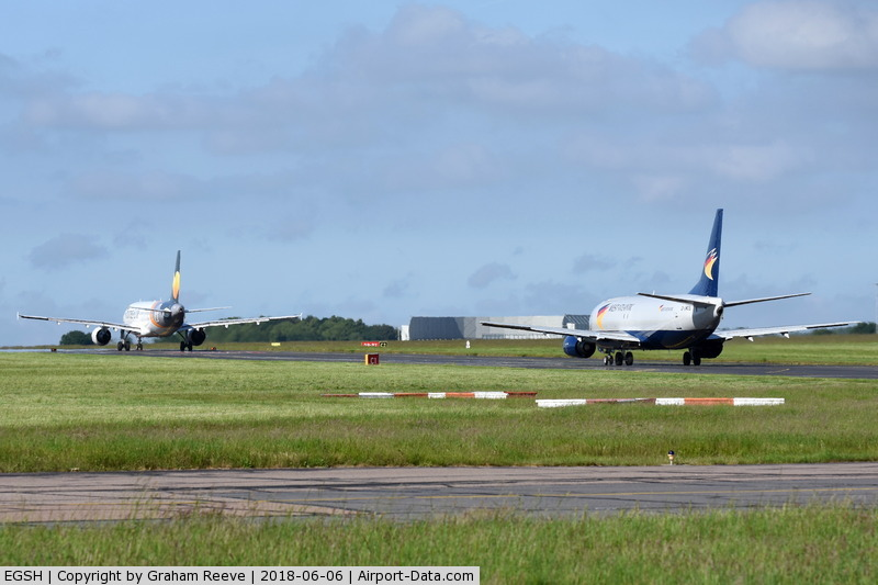 Norwich International Airport, Norwich, England United Kingdom (EGSH) - YL-LCO and G-JMCS both on taxiway Charlie.