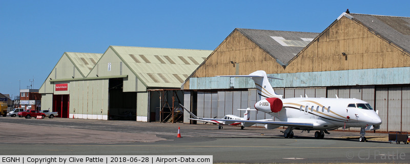 Blackpool International Airport, Blackpool, England United Kingdom (EGNH) - Apron view, showing WWII era hangarage, at Blackpool